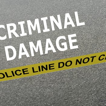 3D illustration of CRIMINAL DAMAGE title on the ground in a police arena. Police concept